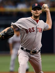 Boston Red Sox starter Chris Sale pitches to the Tampa Bay Rays during the first inning of a baseball game Thursday, July 6, 2017, in St. Petersburg, Fla. (AP Photo/Steve Nesius)