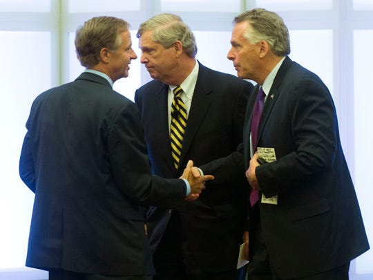 U.S. Agriculture Secretary Tom Vilsack, center, along with Tennessee Gov. Bill Haslam, left, and Virginia Gov. Terry McAuliffe shake hands after holding a town hall meeting to address the opioid epidemic in Appalachia on Thursday, June 30, 2016, at the Southwest Virginia Higher Education Center in Abingdon, Va.