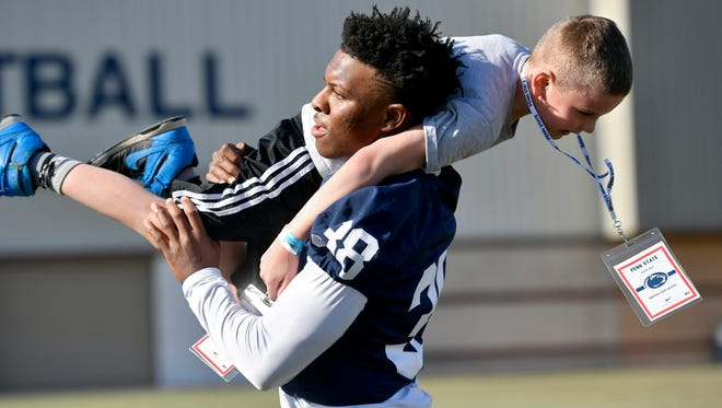 """Penn State rookie Lamont Wade, shown here helping at THON weekend, is not shy about sharing his social views. He posted a YouTube video about his thoughts on the NFL protests over the American flag and national anthem. """"Take a knee or sit for injustices, for what you believe in, for what you want to fight for."""""""