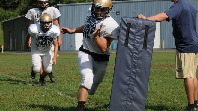 Lancaster's Josh Cook runs through a drill during Monday's practice.