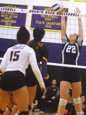 Rutherford's Jill Griggs (22) going up for a block against Bogota in Group 1 state semifinals.