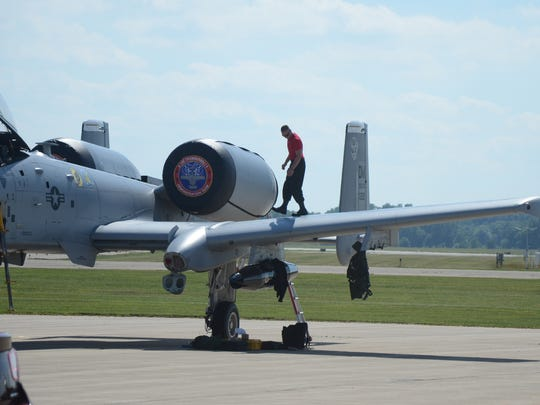 Crew members inspect the A-10 after it landed in Battle Creek on Thursday.