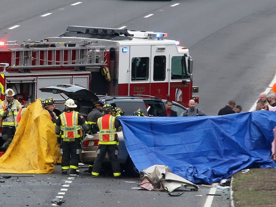Police and firefighters on scene along Route 9 North just north of the County Route 516 access road where a crash occurred on Tuesday March 15, 2016.