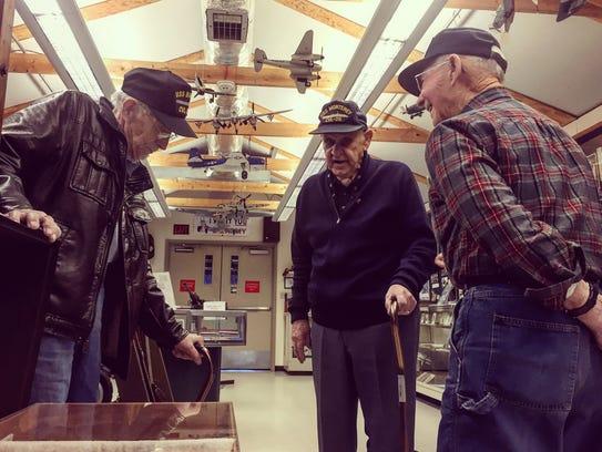 World War II Navy veterans (from left) Ed Turner, Owen