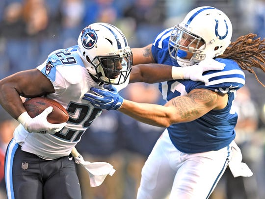 Titans running back DeMarco Murray (29) is stopped