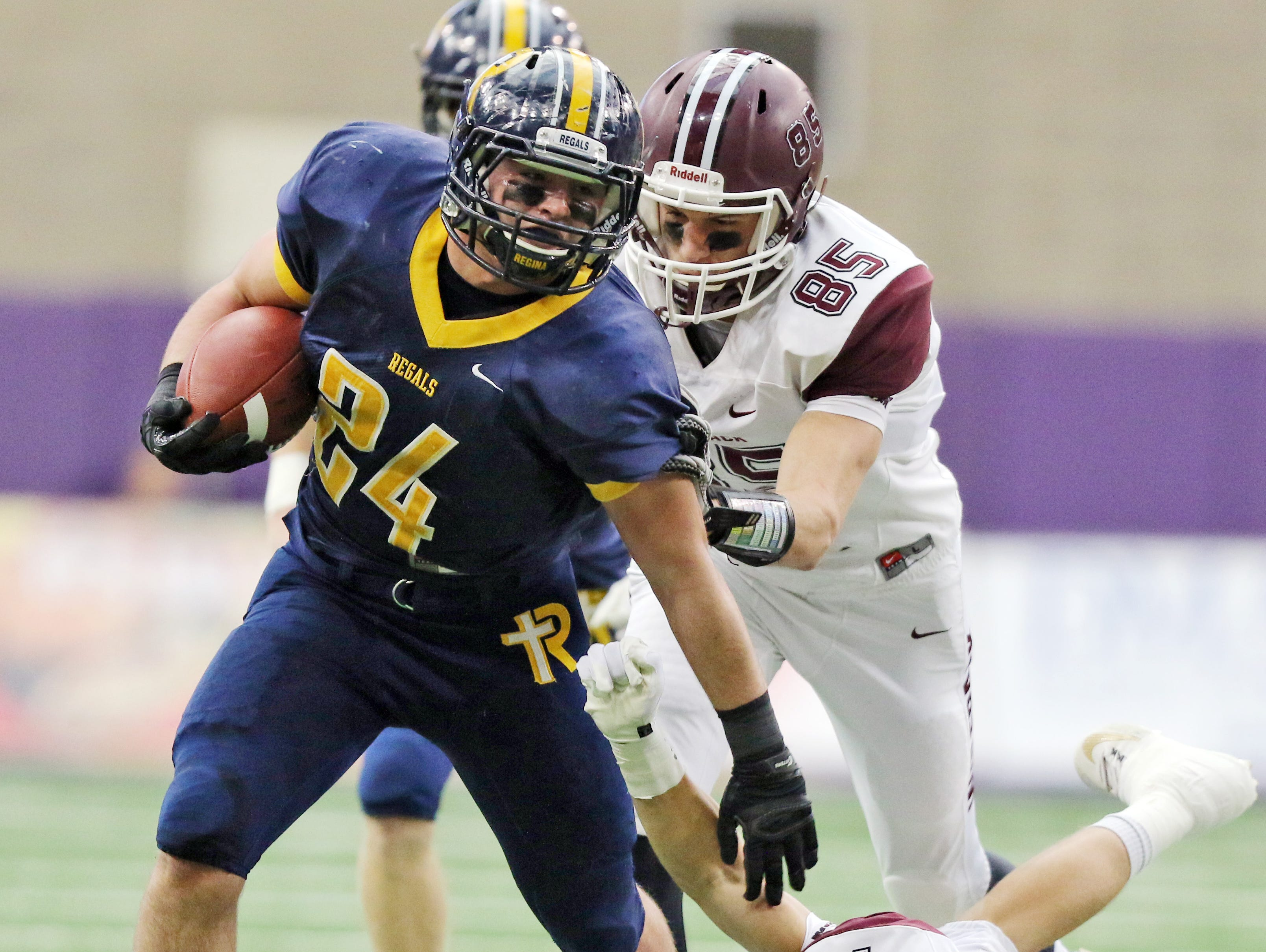 Justin Hunter of Iowa City Regina runs the ball in the Class 1A Championship game with Western Christian Hull Monday, Nov. 23, 2015. The Regals won their sixth consecutive state championship.