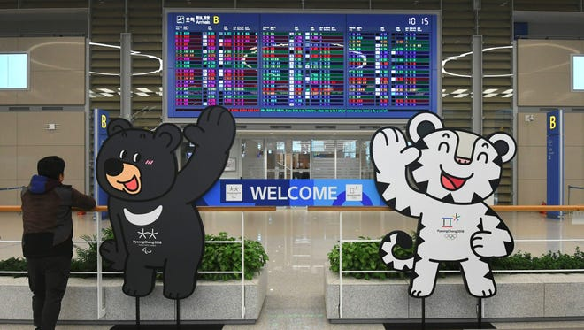 The mascots of the 2018 PyeongChang Winter Olympics are set at the arrival gate of Terminal 2 of Incheon International Airport, west of Seoul, on Jan. 18, 2018.
