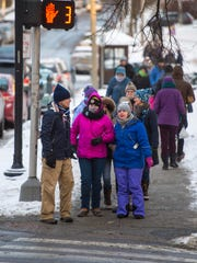First Night Burlington revelers bundle up against the