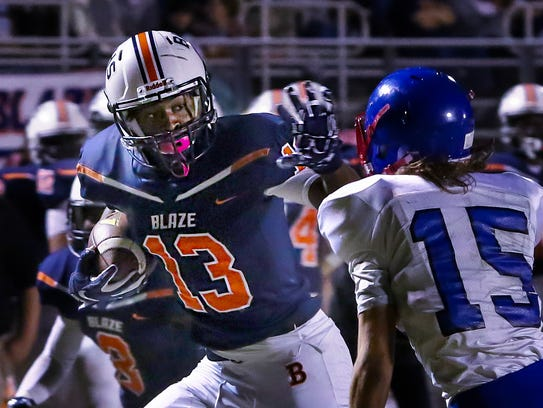 Blackman's Trey Knox looks for running room after a
