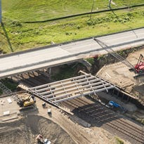 An aerial image shows the M-100 bridge slide project in Potterville still under construction. The new bridge was completed and put in place by Monday evening.