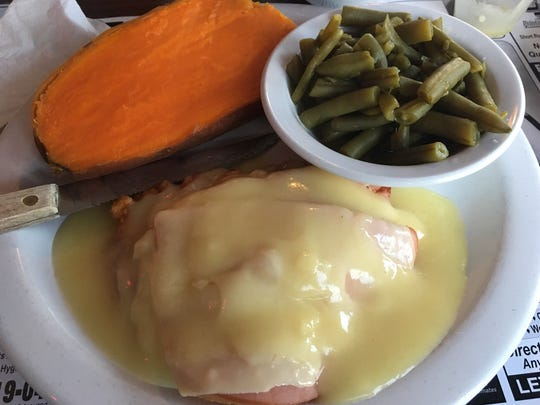 Dino's Family Restaurant's chicken cordon blue was a thin chicken cutlet breaded and fried topped with sliced ham and melted Swiss cheese served with a light Dijon cream sauce. The vegetables, however, came from a can.