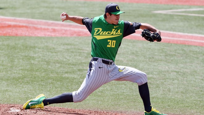 Oregon's Stephen Nogosek pitches against Oregon State at Goss Stadium in Corvallis Sunday April 27, 2014.