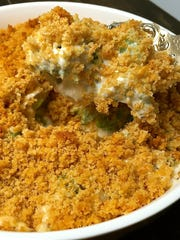Ritz cracker crumbs top this cheesy broccoli casserole, which can be prepared ahead.