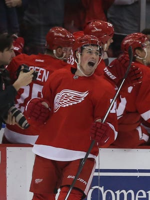 Detroit Red Wings center Dylan Larkin celebrates after scoring a goal against the New York Islanders at Joe Louis Arena.
