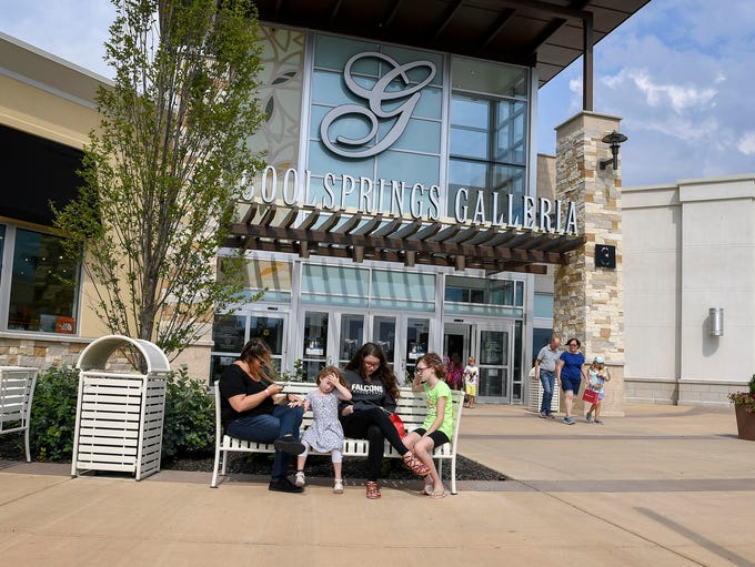 Customers rest after shopping at the Cool Springs Galleria