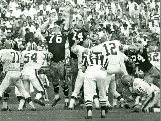 Mike Tilleman (74) of the New Orleans Saints leaps