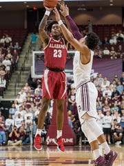 Mar 3, 2018; College Station, TX, USA; Alabama Crimson Tide guard John Petty (23) attempts a shot over Texas A&M Aggies guard Admon Gilder (3) during the first half at Reed Arena. Mandatory Credit: C. Morgan Engel-USA TODAY Sports