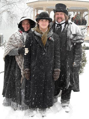 Re-enactors don Victorian garb at the Dickens Christmas celebration in Skaneateles.
