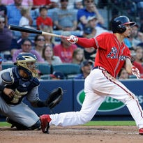 Atlanta Braves infielder Jace Peterson hits the game-winning single to score teammate Alberto Callaspo in the 11th inning against the Milwaukee Brewers.