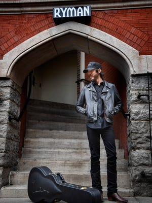 American singer songwriter Chris Janson stands in the alley between Tootsie's Orchid Lounge and Ryman Auditorium in Nashville,  Tenn., Tuesday, Jan. 23, 2018.