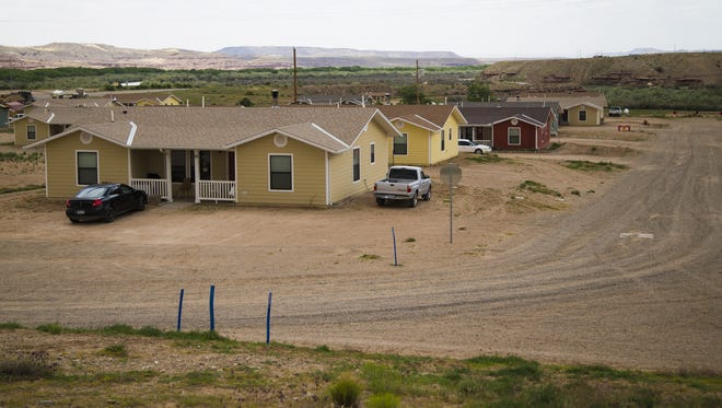 Houses built by the Navajo Housing Authority in Aneth, UT May 12, 2015. Some residents claim they were poorly constructed by the NHA. Despite the NHA having over a quarter of a billion dollars of unspent grant money, many Navajos live in poor conditions.