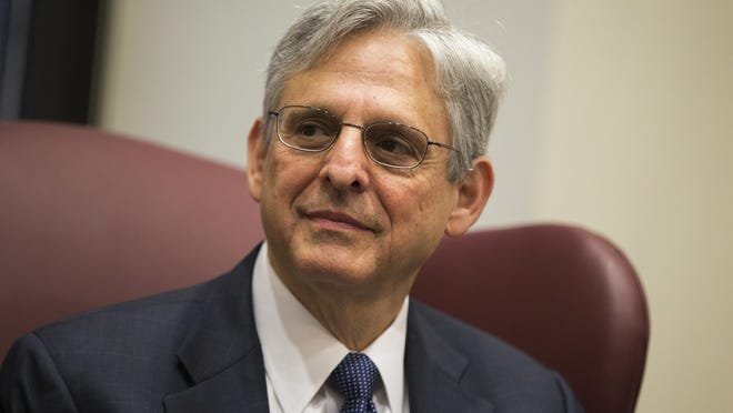 Judge Merrick Garland, President Barack Obama's choice to replace late Justice Antonin Scalia on the Supreme Court, meets with Sen. Gary Peters, D-Mich., on Capitol Hill, on April 28.