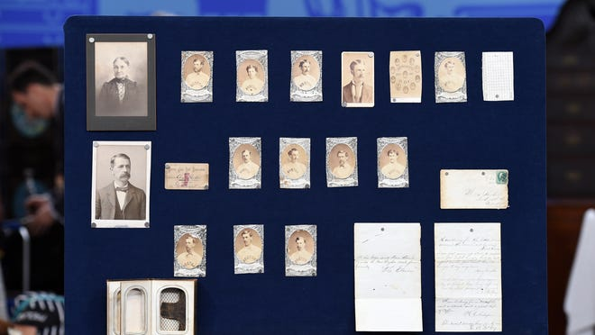 """This Aug. 9, 2014 photo released by Antiques Roadshow shows a collection of early Boston baseball memorabilia for the program """"Antiques Roadshow"""" in New York. This is the largest sports memorabilia find in the program's 19-year history, valued at $1 million."""