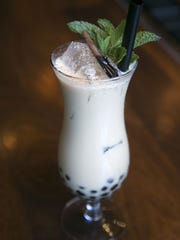 """The signature cocktails the """"Boba Tea"""" at Blue Hound"""