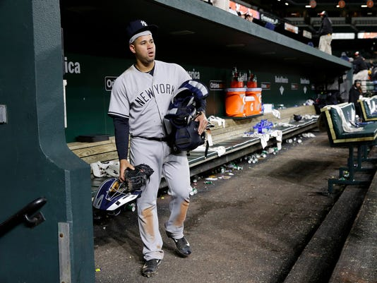 New York Yankees catcher Gary Sanchez walks out of an empty dugout after a baseball game against the Baltimore Orioles in Baltimore, Friday, April 7, 2017. (AP Photo/Patrick Semansky)