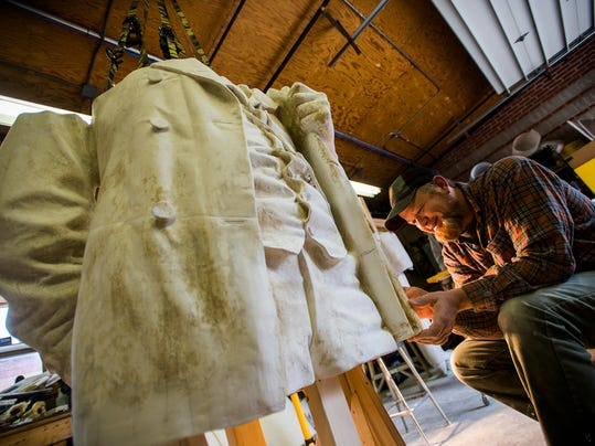 National Park Service exhibit specialist Brian Griffin works on preserving details in the coat of a pattern for the famous Augustus Saint-Gaudens statue, 'Abraham Lincoln: The Man' on June 4.