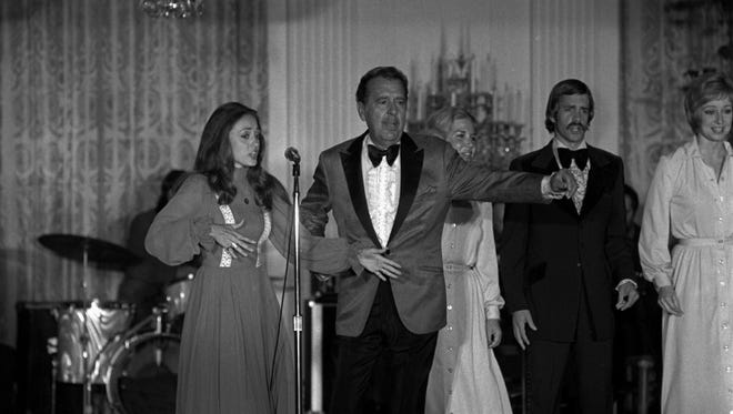 Singer Tennessee Ernie Ford entertaining at the White House in a June 1975 file photo.