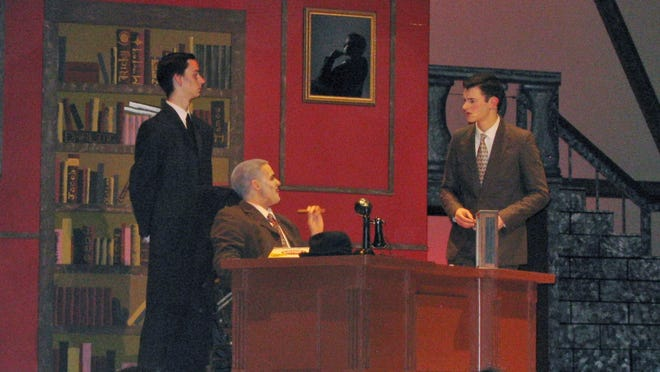 George Bailey (on the right) pleads with Mr. Potter (Mathew Fioravanti, seated) not to have him arrested for fraud.
