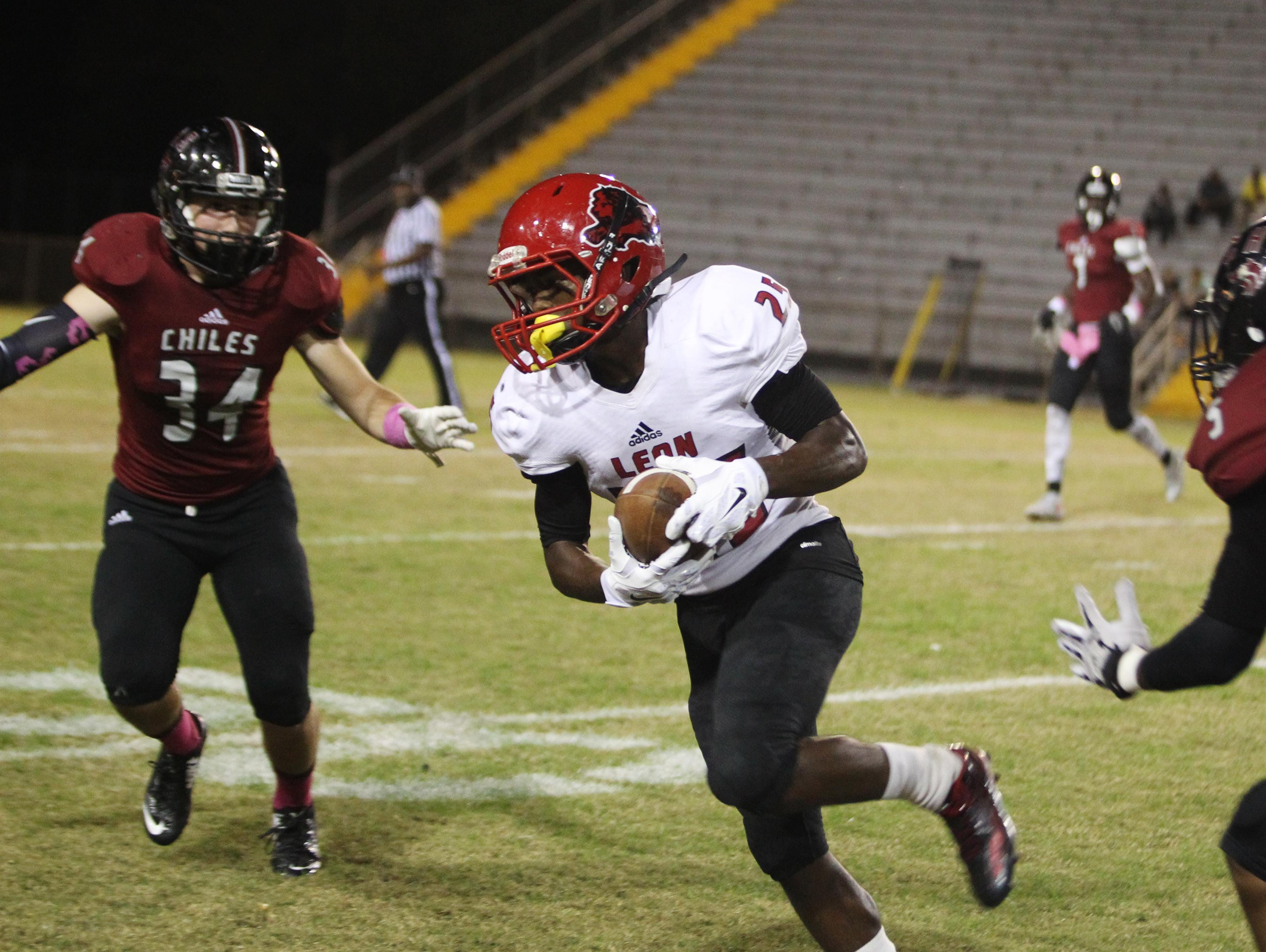 Leon receiver Javier Ferrer runs after a catch. Ferrer made the game-winning 21-yard TD catch with 28 seconds left on a fourth-down play to win 22-21 over Chiles.