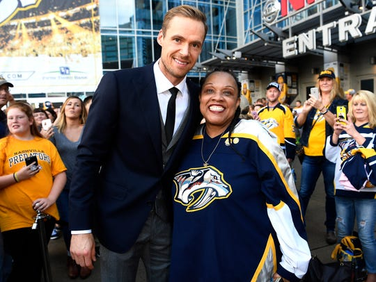Pekka Rinne poses with Deborah Reynolds during the