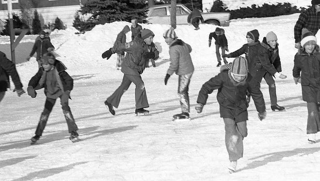 SNAPSHOT IN TIME: Kewaunee kids were having a good time skating at Haney Park on the day Harold Heidmann stopped to snap the photo. One hundred or more years ago, kids and adults delighted in skating frozen rivers, creeks and ponds. Skating on the Ahnapee River was fairly good in December 1911 when George Zeimer flooded a large tract of land to build a rink near his Sixth Street home in Algoma. Zeimer's smooth, clean rink was an attraction. Heidmann's photos can be found at Algoma Public Library.
