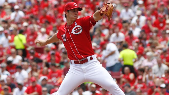 Cincinnati Reds starting pitcher Michael Lorenzen throws against the Miami Marlins in the third inning of a baseball game against the Miami Marlins, Sunday, June 21, 2015, in Cincinnati.