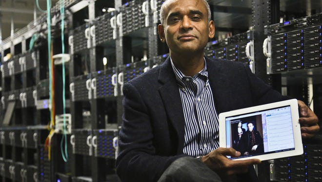 This Dec. 20, 2012 file photo shows Chet Kanojia, founder and CEO of Aereo, Inc., holding a tablet displaying his company's technology, in New York.  The Supreme Court has ruled that a startup Internet company has to pay broadcasters when it takes television programs from the airwaves and allows subscribers to watch them on smartphones and other portable devices. The justices said Wednesday by a 6-3 vote that Aereo Inc. is violating the broadcasters' copyrights by taking the signals for free. The ruling preserves the ability of the television networks to collect huge fees from cable and satellite systems that transmit their programming.