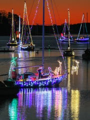 A sailboat follows others in the 2nd annual Western Carolina Sailing Club marina Parade of Lights in Lake Hartwell on Friday, December 9th in Anderson County. A second one is scheduled to leave the club at 6 p.m., with the two-dozen sailboats circling between the S.C. Highway double bridges, Green Pond Boat Landing, and Portman Marina, the the best view from the boat landing.