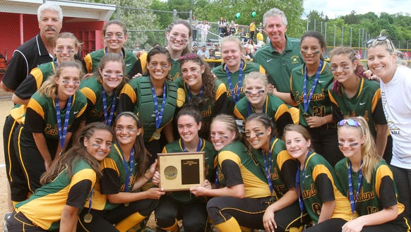 Lakeland players celebrate with the Section 1 plaque