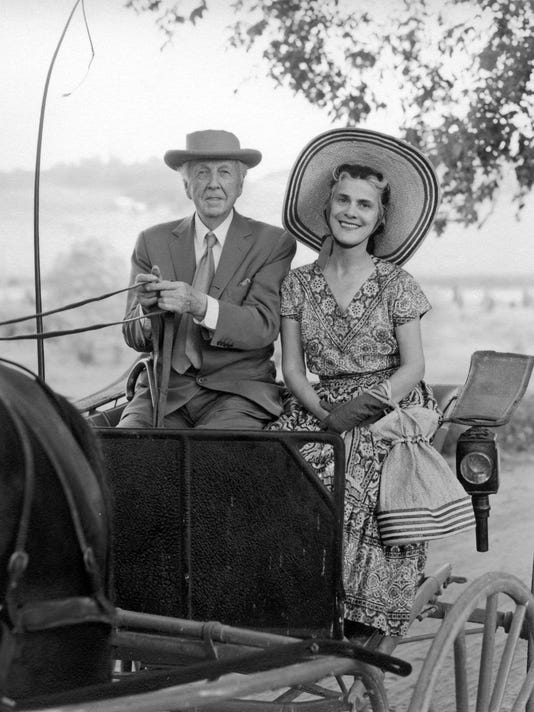 636314198564685342-6203-0191---Frank-Lloyd-Wright-and-his-wife-Olgivanna-in-their-side-bar-phaeton.jpg