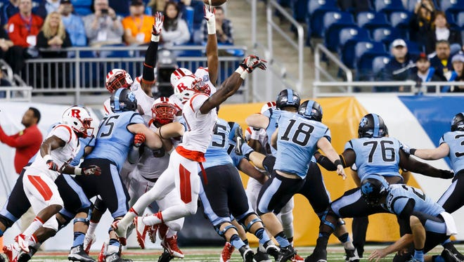 Rutgers defensive lineman Quanzell Lambert blocks a North Carolina field-goal attempt in the second quarter in the 2014 Quick Lane Bowl at Ford Field on Friday.
