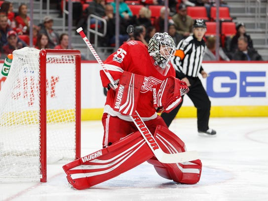 Red Wings goalie Jimmy Howard (35) makes a save during