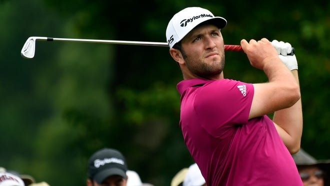 Jon Rahm tees off on the 13th hole during a practice round.