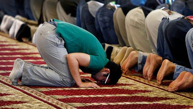 Khaled Mhaissen takes part in a prayer service at Masjid Ar-Rahman mosque June 27, 2014.