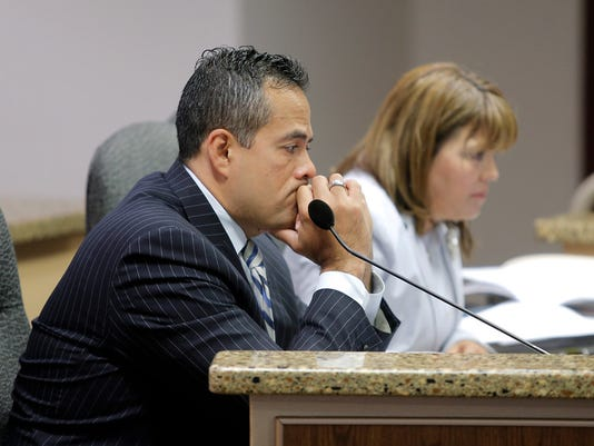 """""""MARK LAMBIEÑEL PASO TIMES  El Paso City Manager Tommy Gonzalez listens to a discussion on parks during Tuesday's city council meeting. """""""