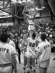 Manitowoc senior Bill Sepnafski cuts down the nets after the Ships won the sectional championship at JFK Fieldhouse on their way to winning the 1968 state title.