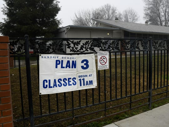 A sign near Sundale Union School District's main entrance displays the schools foggy day schedule plan on Tuesday morning.