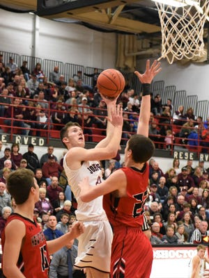 Josh Raley shoots the ball against New Philadelphia in Saturday's district finals. Raley is the lone returning starter off last year's regional finals team.