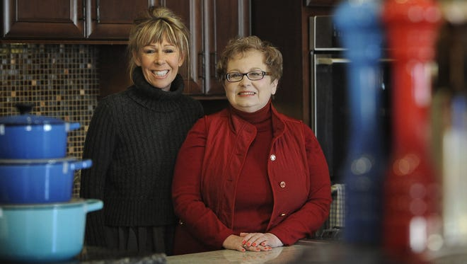 Penny Klinedinst, owner of Simply Perfect, is buying Plum's Cooking Co. from Caroline Petersen.