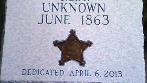 This tombstone, dedicated in April 2, 2013, replaced